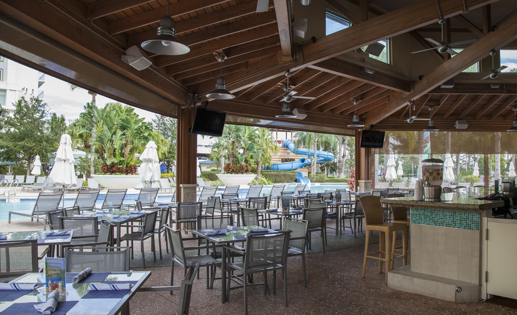 Tropics bar grill covered patio for Balcony grill and bar
