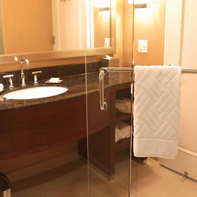 Refresh in the upscale bathroom of the Executive level with granite vanity and walk-in shower.